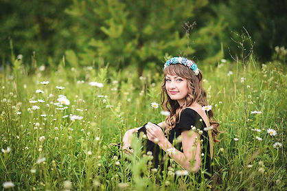 Happy earth child in chamomile garden