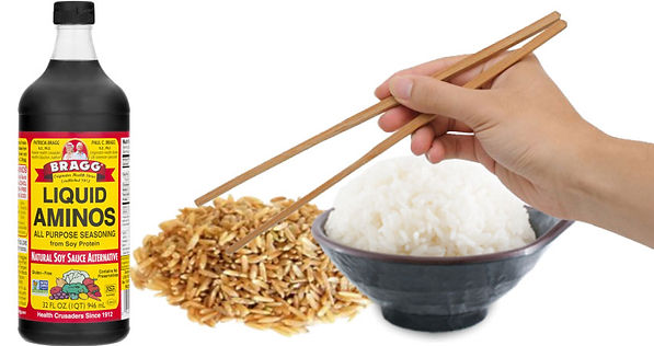 Bowl of white rice and brown rice next to Braggs Natural Soy Sauce.