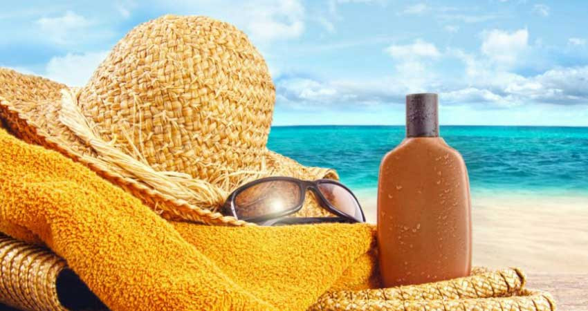 Beach hat, sunglasses, towel and sunscreen.