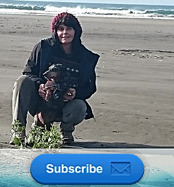 Reni and Scampy at the beach, for the newsletter.