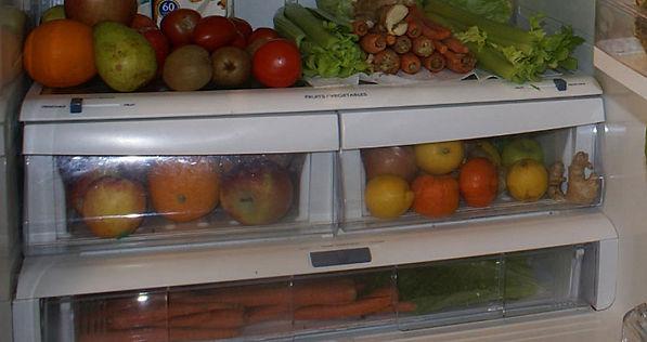 Fridge full of fruits and vegetables.