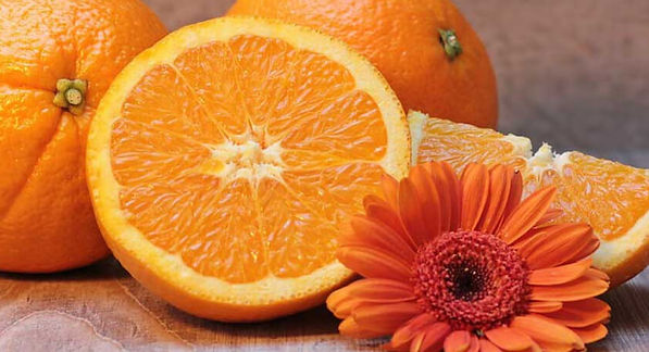 Orange flower and sliced oranges.