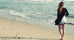 Woman walking the beach. Manage Stress- Healthy Body  Happier Life.