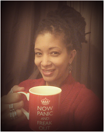Photo of Trina holding a cup of coffee, with the words Now Panic and Freak out.