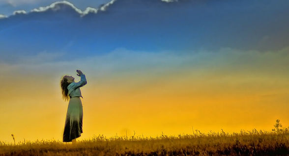 Woman looking to heaven and praying to God. In Search of Spirit.