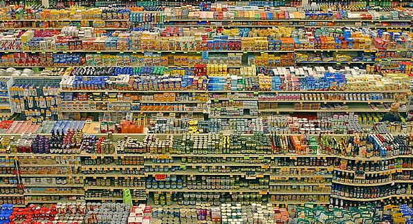 Super Market aisle lined with processed foods.