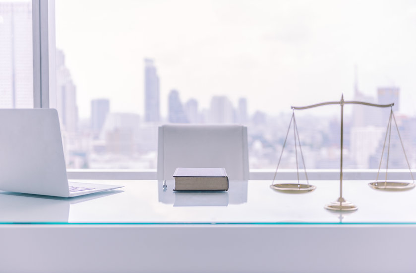 law books,computer and scales of justice