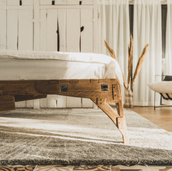 Oak bed handmade in room design closeup