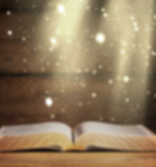 Open bible and black background.jpg