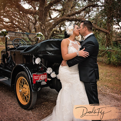Bride & Groom Wedding Photo Arching Iaks, Labelle Florida 20's, 30's, 40's, Harry potter Theme, Photo By Doodle Fly Photography www.DoodleFlyPhotos.com