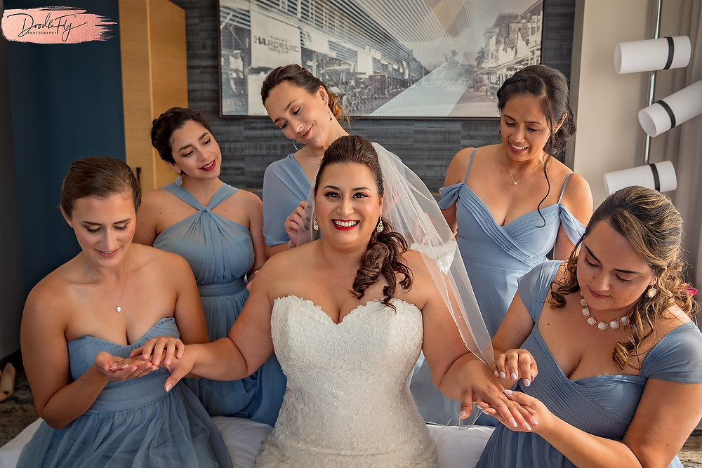 Doodle FLy Photography wedding photo of Bride and bridesmaids getting ready  at Burroughs Home Venue in Fort Myers Florida