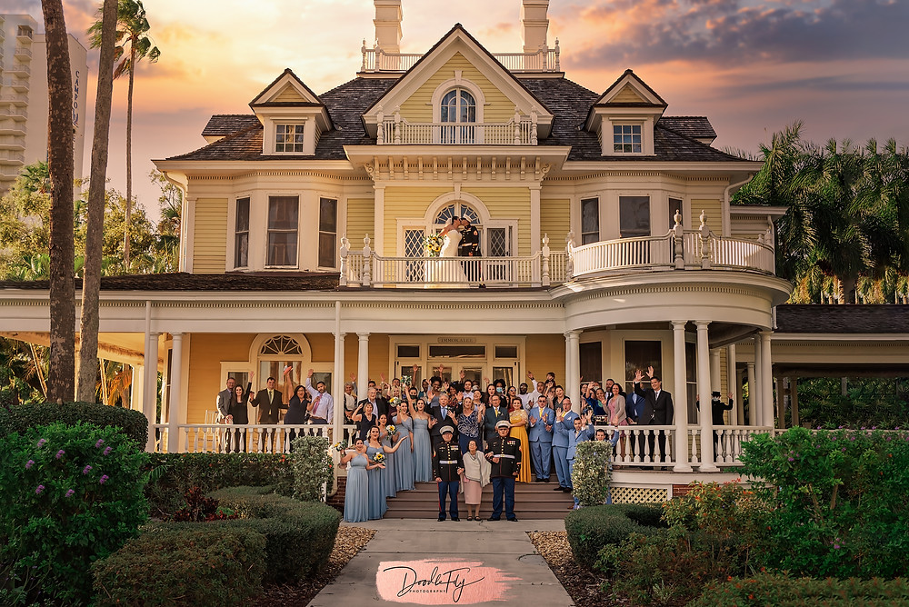 Doodle FLy Photography wedding photo of Group photo of wedding party and guests in the front of home at Burroughs Home Venue in Fort Myers Florida