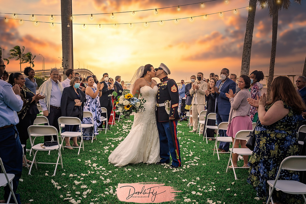 Doodle FLy Photography wedding photo of bride and groom kissing at Burroughs Home Venue in Fort Myers Florida