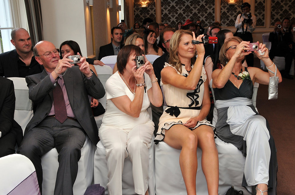 wedding_guests_at_cannizaro_house_with_their_cameras