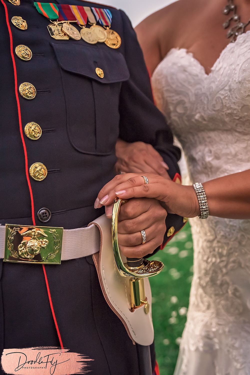 Doodle FLy Photography wedding photo of bride and groom with Navy Uniform and gown with wedding rings  at Burroughs Home Venue in Fort Myers Florida