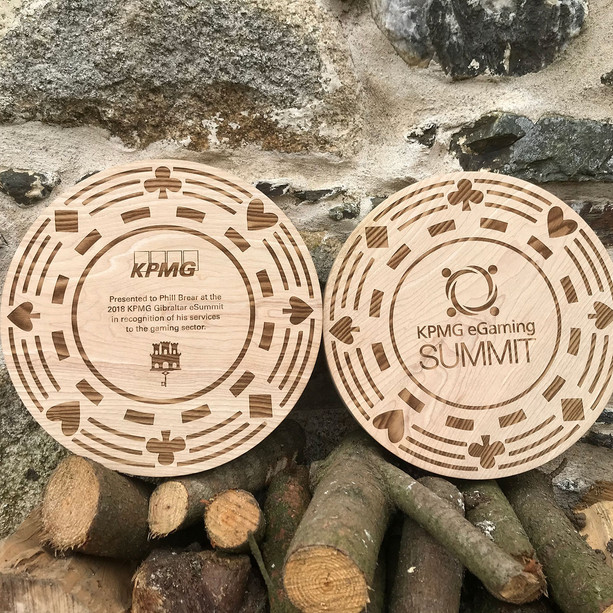 KPMG solid oak giant turned poker chips 30cm diameter, with etched poker chip design, logos and text.