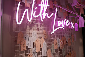 Neon writing attached to a metal mesh for retailer Birchbox at their London POP-up shop. Created and Installed by Stylo