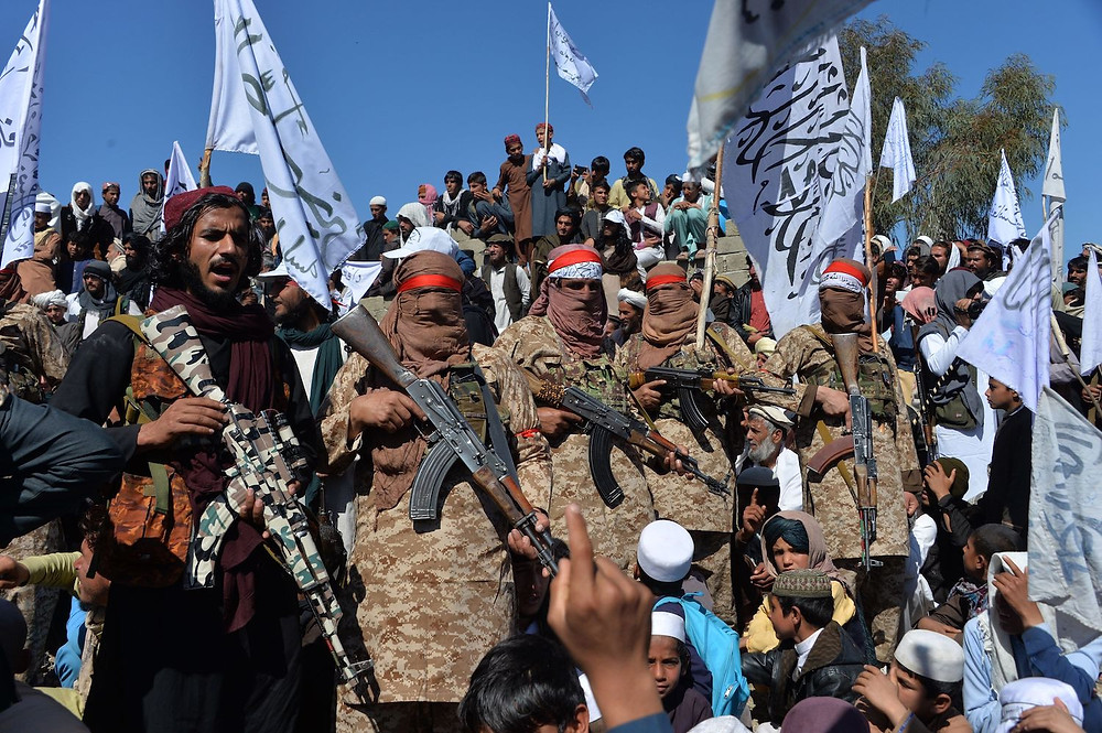 Taliban militants celebrating US-Afghan peace deal, Noorullah Shirzada/AFP/Getty Images