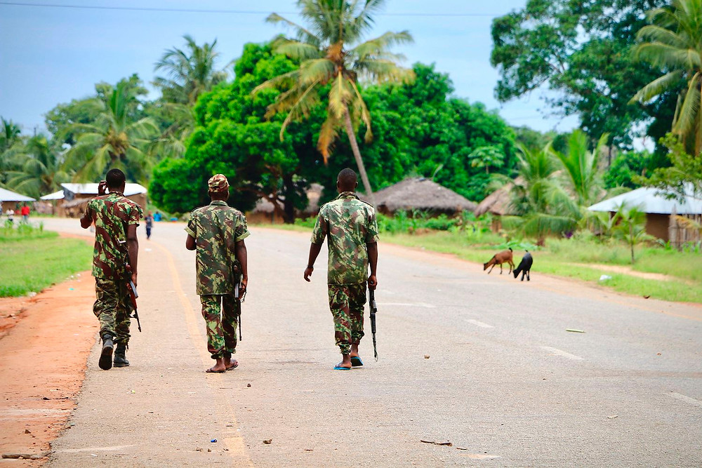 Soldiers from the Mozambican army patrol Mocimboa da Praia, Mozambique, on March 7, 2018, following October's two-day attack by suspected Islamists. ADRIEN BARBIER/AFP VIA GETTY IMAGES, © Foreign Policy 2020