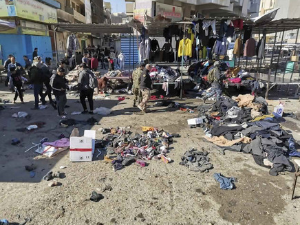 Twin Suicide Bombings In Baghdad Market Kill At Least 32, Wound Over 100
