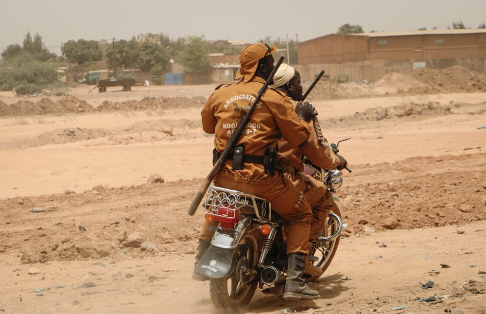 Local Defense Force Fighters on Motorbike, AP Photo/Sam Mednick