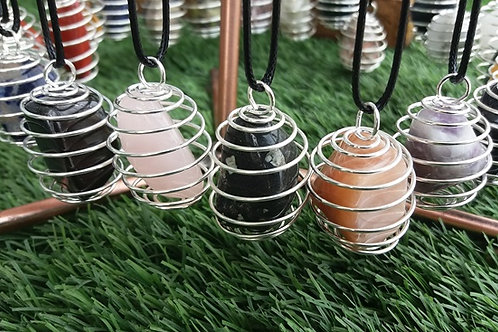 10 x Crystal pendants in a spiral locket with leather chain