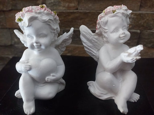 Angel holding a Heart or Dove