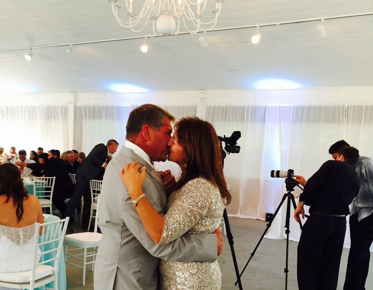 ORFI KISSING COUPLE AT RECEPTION.jpg