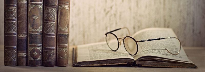 bigstock-Vintage-Books-And-Glasses-32456489_edited.jpg