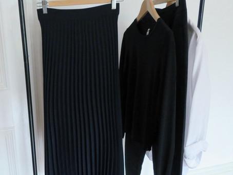 The navy pleated skirt