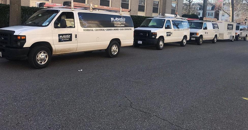 Company vehicles lined up.jpg