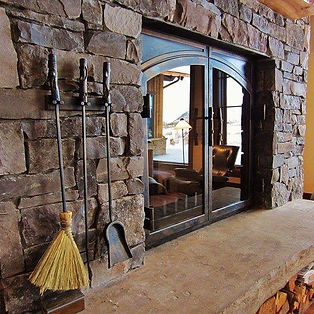 Hand-forged fireplace doors and tools made in Whitefish Montana – Samuel J. Welch, Artisan Blacksmith