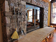 Hand-forged fireplace doors and tools made by artisan blacksmith Samuel J. Welch | Whitefish, MT