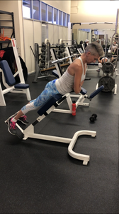 Back extensions with the feet rotated out to work the glutes 2 ways