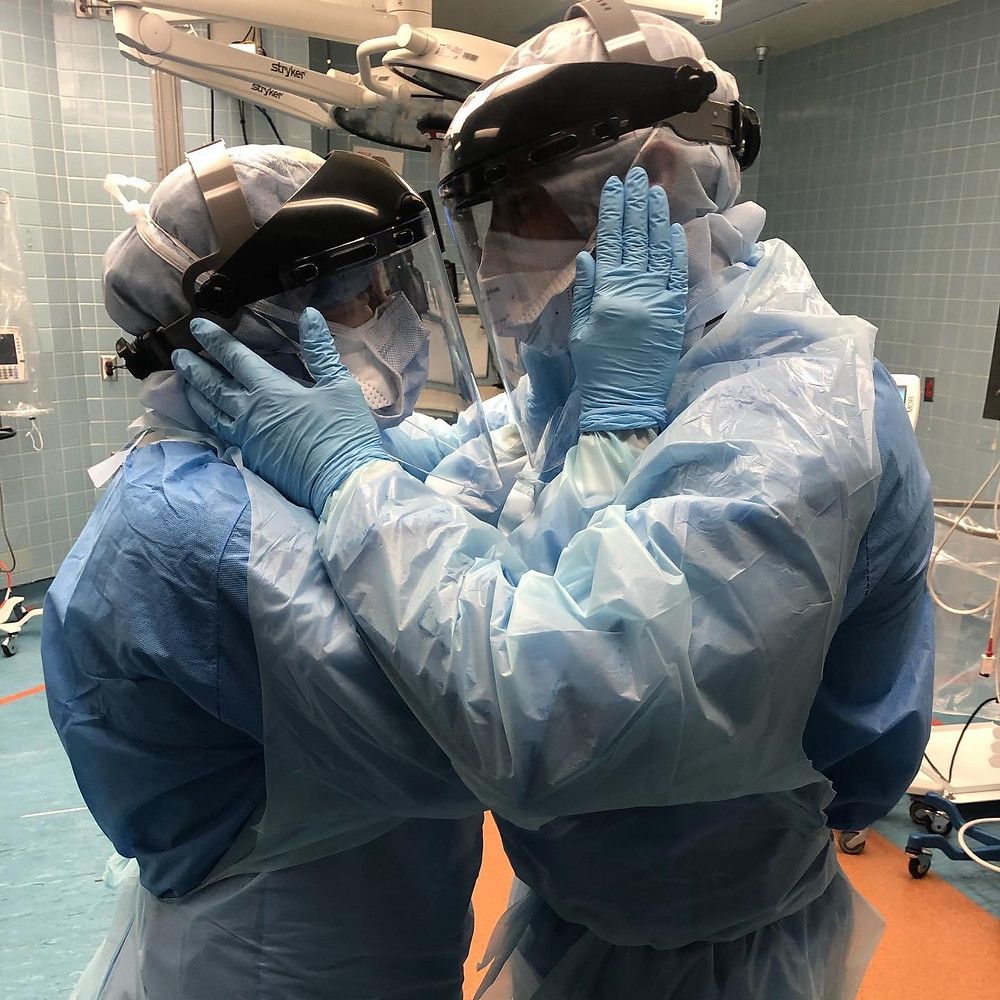 Husband and wife anesthesiologists before working on Covid 19 patients in Tampa Florida. Photo by Nicole Hubbard.