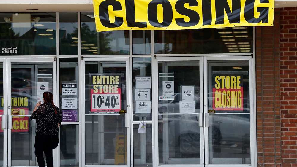 A woman in St. Charles, Missouri walks into a Gordmand's, which is closing all 42 stores and declaring bankruptcy.