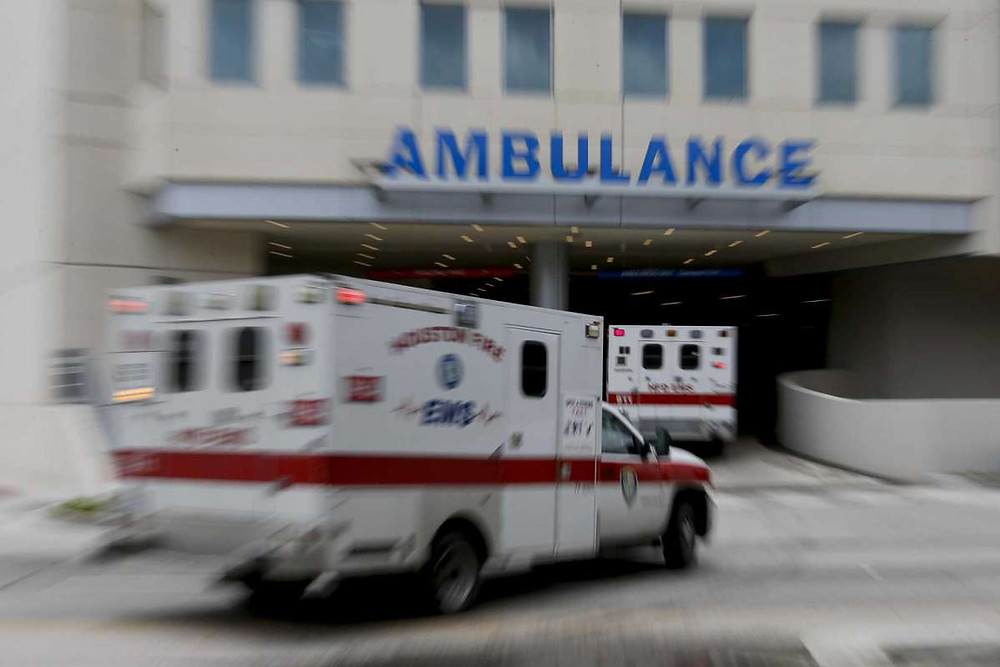 Ambulances arrive at the emergency wing of Houston's Memorial Hermann on Wednesday. The Medical Center projected ICU base capacity will be 100% full by Saturday, and surge capacity exhausted by July 8 at current rates.