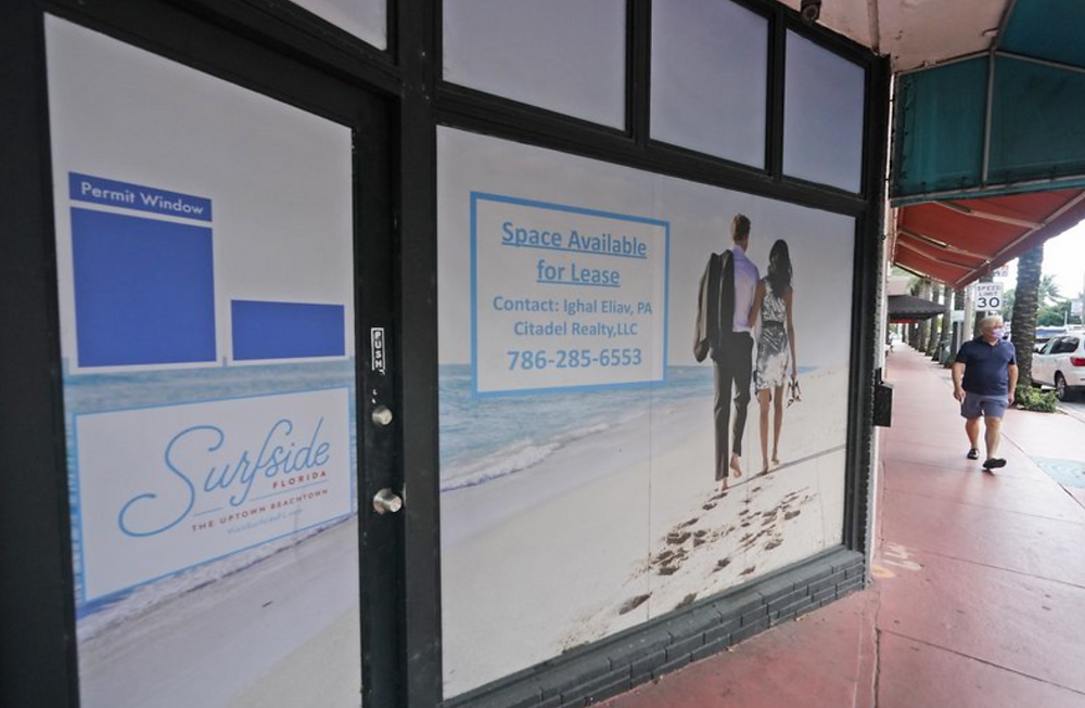 A pedestrian walks by an empty business with space for lease in October in Surfside, Florida