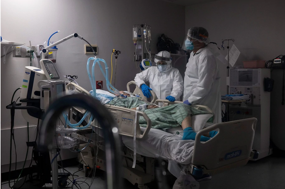 Medical workers treat a patient in the covid-19 intensive care unit at United Memorial Medical Center in Houston