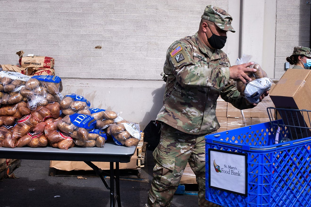 National Guard assist at Phoenix Arizona food-bank while thousands waited in for our car line for aid
