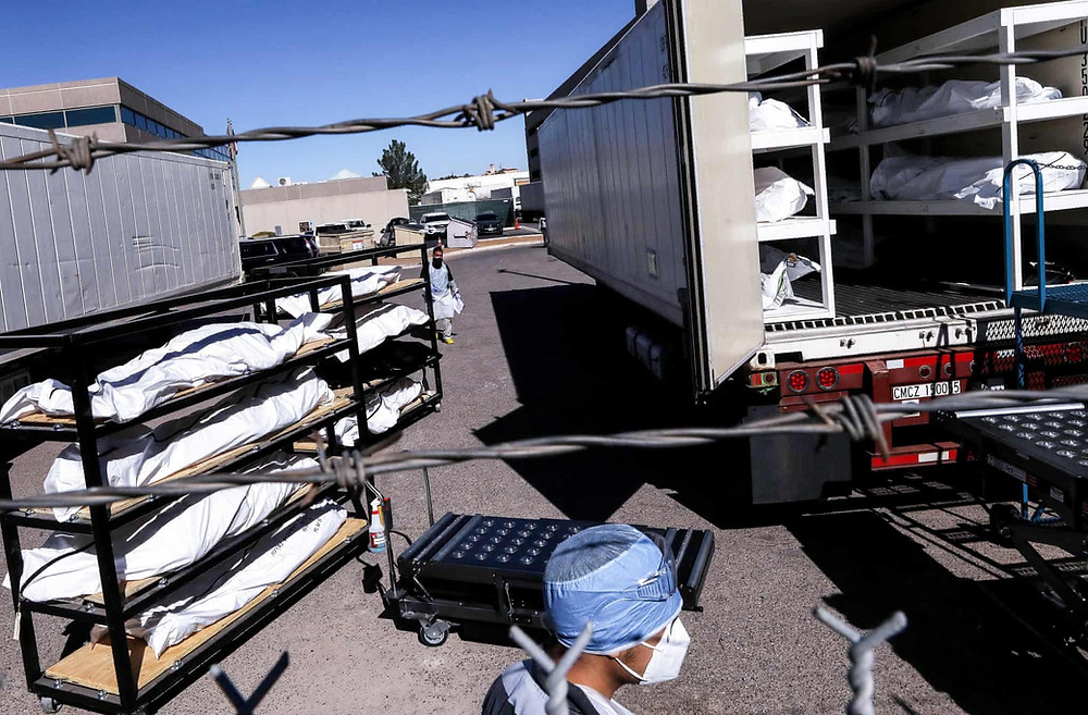 El Paso Texas inmates load Covid-19 corpses into refrigerated trailers due to overflowing morgues and insufficient labor to handle the work.