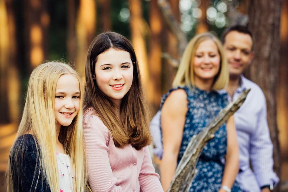 Family in forest, Frensham Ponds, Surrey