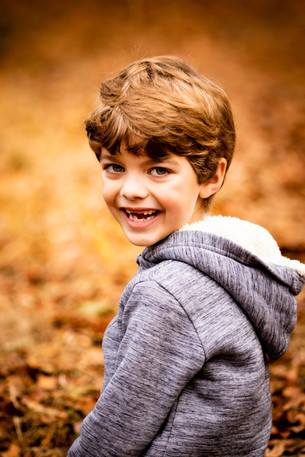 Autumn photograph of young boy, West Sussex