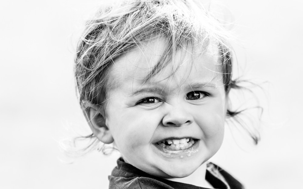 Cheeky smile, young boy, West Sussex