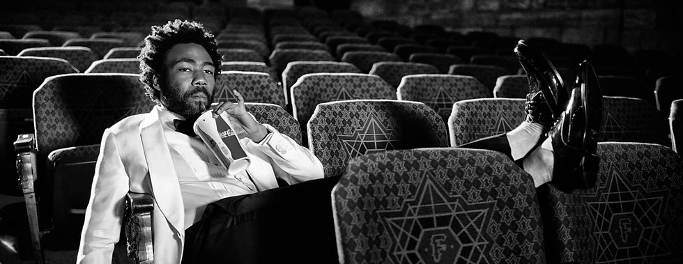 donald-glover-in-movie-theatre-sipping-a