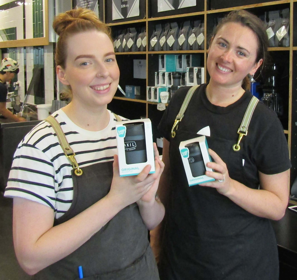 Sam and Casey from Axil on Burwood Road with in-store reusable cups for purchase.