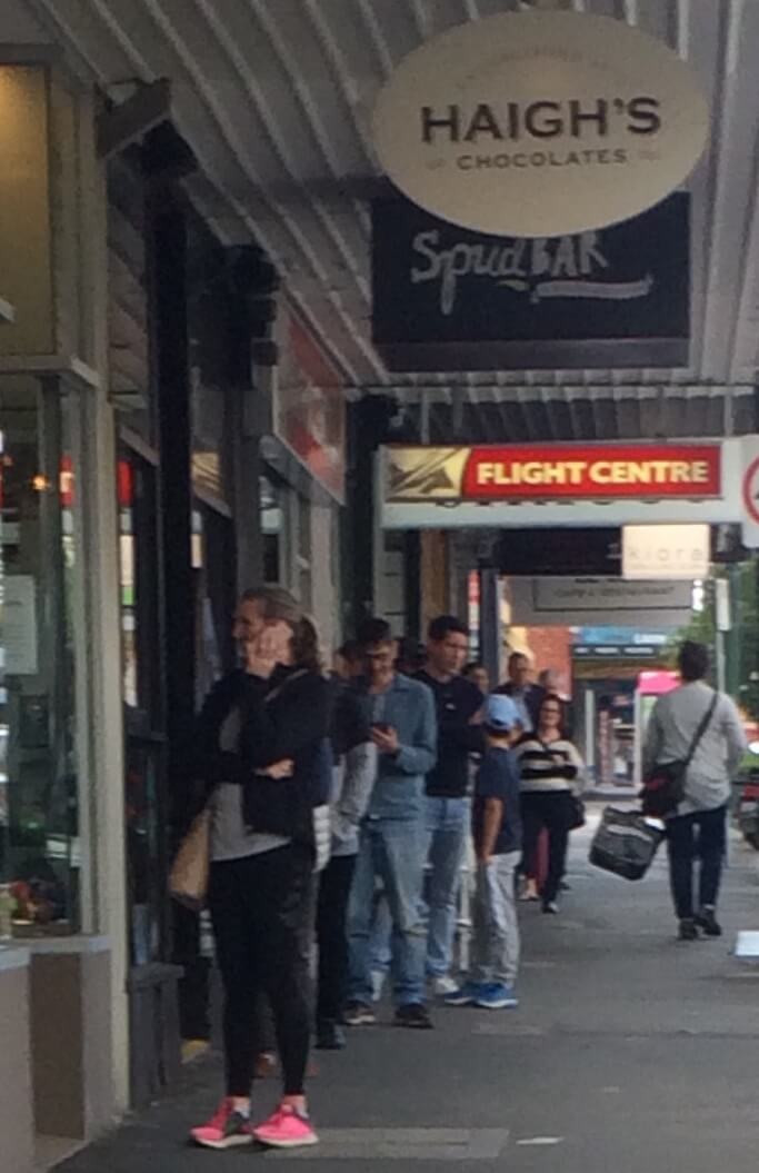 Spaced-out queue outside of Haigh's Chocolates, 715 Glenferrie Road.