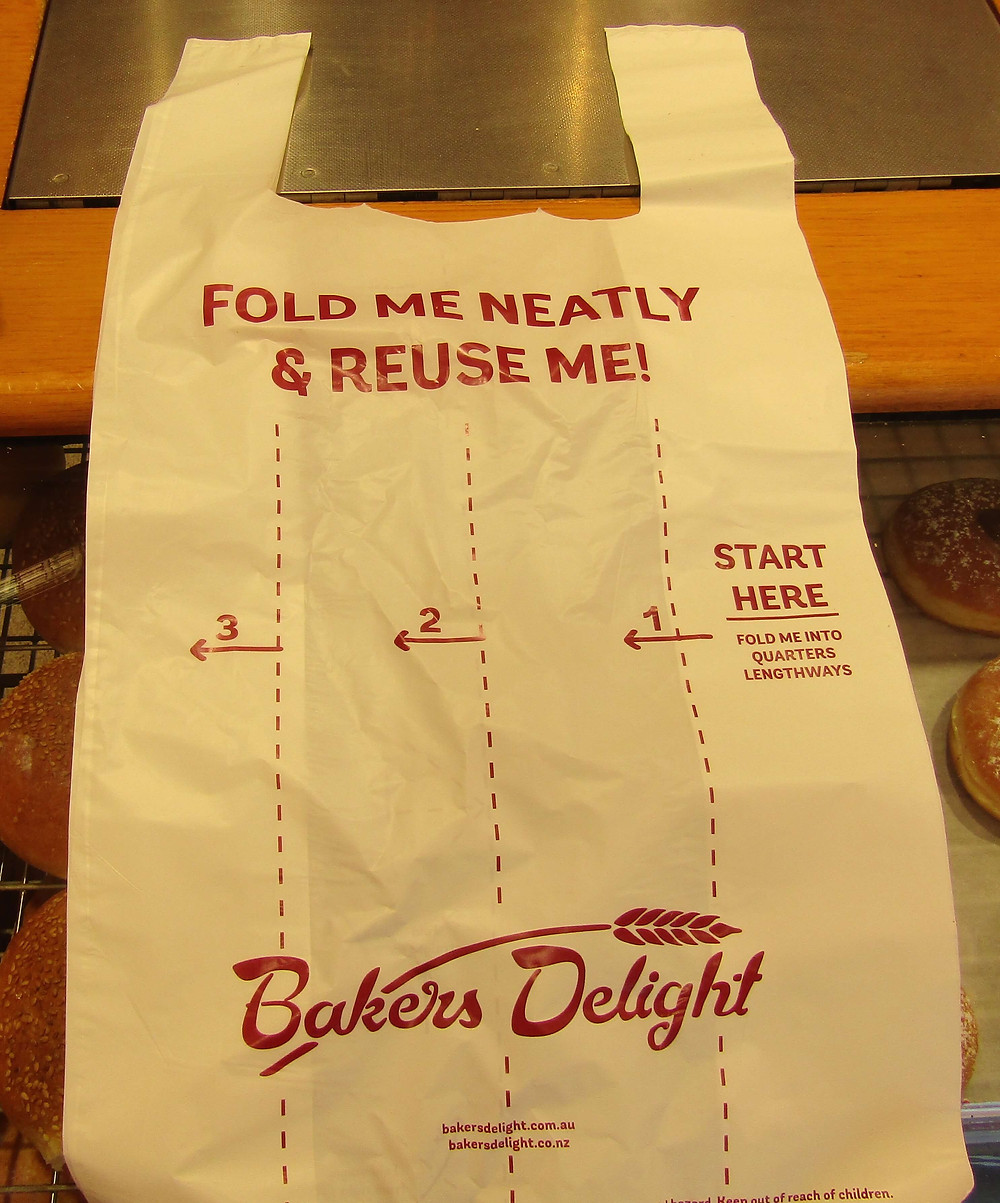 Bakers Delight plastic bags demonstrating how to store for reuse.