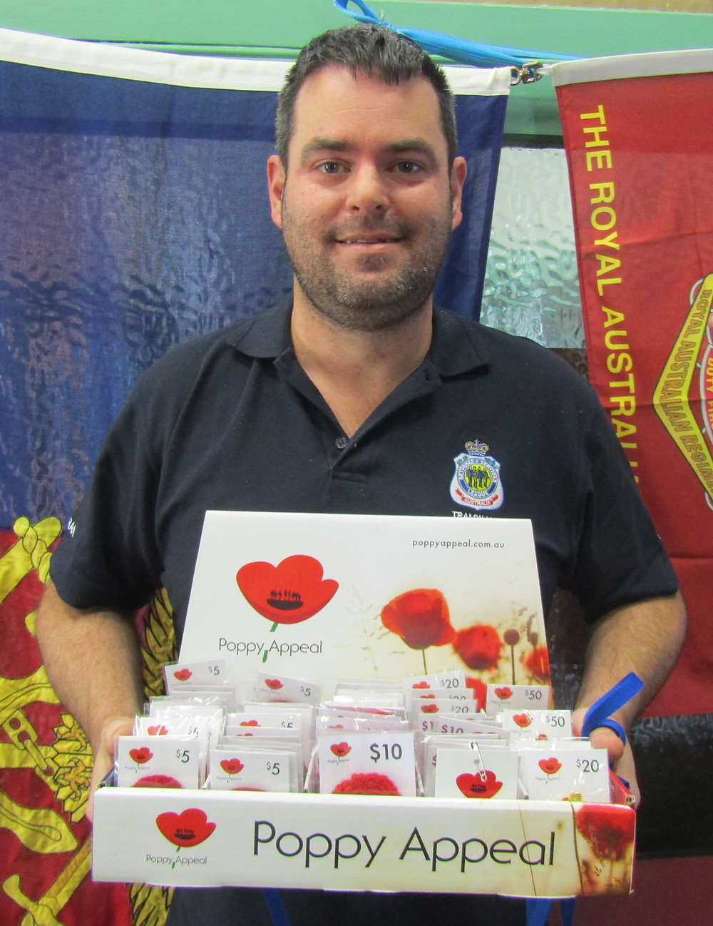 Lucas Moon, President of the Hawthorn RSL, with this year's Poppy Appeal.