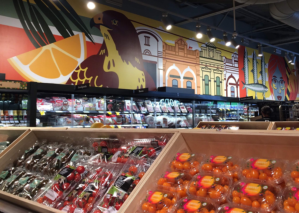 Coles Local Glenferrie locally inspired mural is the backdrop in the fresh food section.